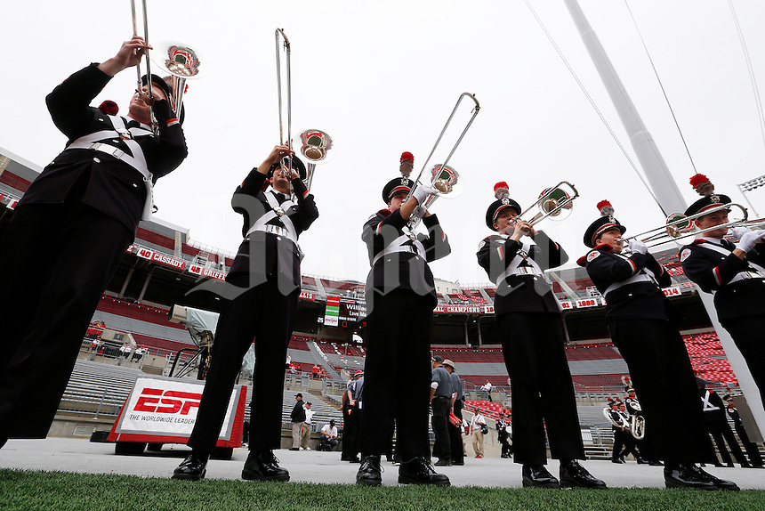 Trombone players in the Ohio State Marching Band practice before the start  of an NCAA football game between the Ohio State Buckeyes and the Western Michigan Broncos  at Ohio Stadium in Columbus, Ohio, on Saturday, September 26, 2015. (Columbus Dispatch photo by Fred Squillante)