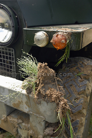 Mud on an early 1960s Land Rover Lightweight Series 2a with headlamps in the radiator panel, Bining, France. --- No releases available. Automotive trademarks are the property of the trademark holder, authorization may be needed for some uses.