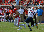 Shea Patterson dodges a defender during the game against UT Martin Sat., Sept. 9, 2017. Ole Miss wins 45-23. Photo by Marlee Crawford/Ole Miss Communications