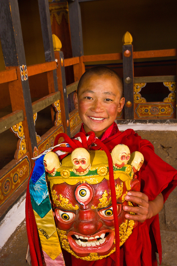 Novice monk with mask, Paro Dzong Monastery Fortress, Paro Valley, Bhutan