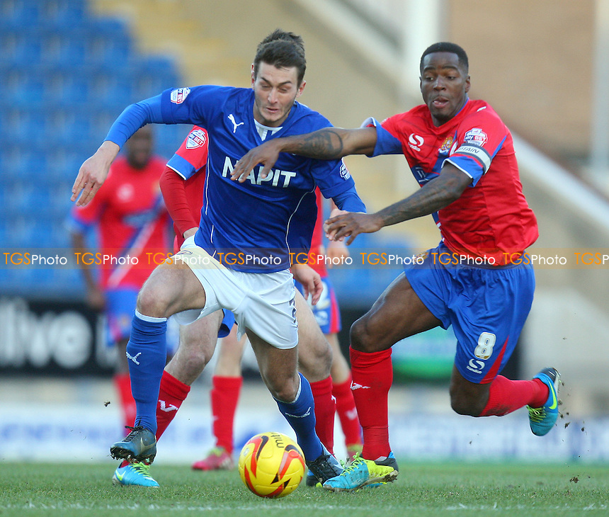 Oliver Banks of Chesterfield and Abu Ogogo of Dagenham and Redbridge - Chesterfield vs Dagenham and Redbridge, Sky Bet Football League football at the Proact Stadium - 29/12/13 - MANDATORY CREDIT: Dave Simpson/TGSPHOTO - Self billing applies where appropriate - 0845 094 6026 - contact@tgsphoto.co.uk - NO UNPAID USE
