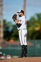Baltimore Orioles relief pitcher Gabriel Ynoa (64) looks in for the sign during a Grapefruit League Spring Training game against the Detroit Tigers on March 3, 2019 at Ed Smith Stadium in Sarasota, Florida.  Baltimore defeated Detroit 7-5.  (Mike Janes/Four Seam Images)