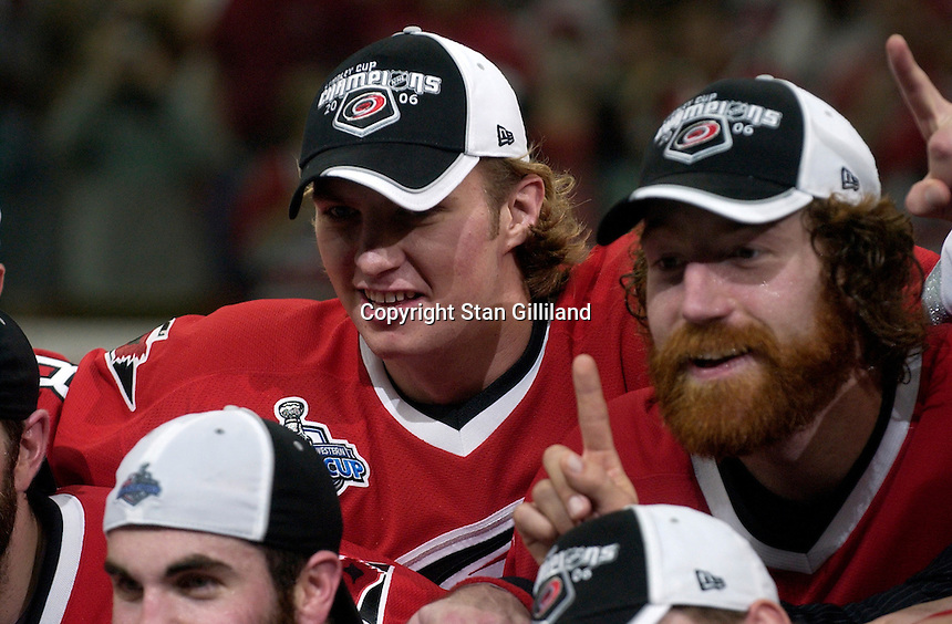 Teammates Anton Babchuk and Mike Commodore, right, gesture to the cameras during a team photo. The Carolina Hurricanes beat the Edmonton Oilers 3-1 in game seven to take the Stanley Cup at the RBC Center in Raleigh, NC Monday, June 19, 2006.