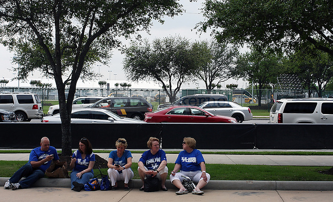 UK fans sit outside and enjoy the Texas sunshine before the Final Four game at Reliant Stadium in Houston, TX for the Final Four on Saturday, April 2, 2011.  Photo by Britney McIntosh | Staff