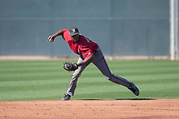 Arizona Diamondbacks shortstop Manny Jefferson (12) prepares to make a throw to first base during a Spring Training game against Meiji University at Salt River Fields at Talking Stick on March 12, 2018 in Scottsdale, Arizona. (Zachary Lucy/Four Seam Images)
