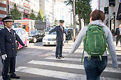 In Japan, security guards and privately employed traffic wardens are often older men working in their retirement.