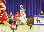 Barclay and Arlington Baptist women in action during the NCAA Basketball game at Arlington Baptist College in Arlington, Texas.