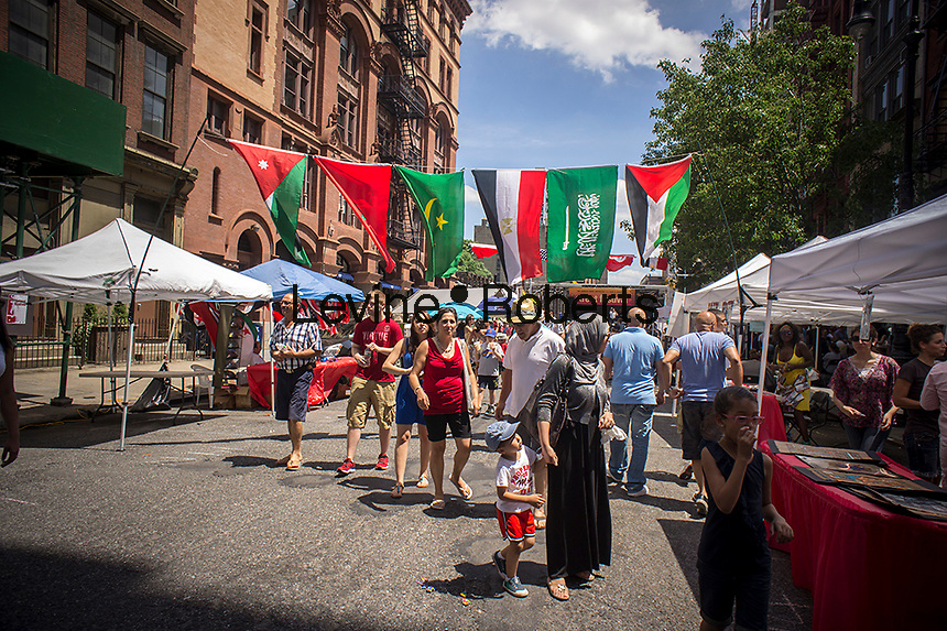 Arab-Americans and visitors gather on Great Jones Street in the Noho neighborhood of New York on Saturday, July 6, 2013 for the 11th annual North African and Arab Street Festival. Visitors to the event, organized by theNetwork of Arab-American Professionals group, were treated to music and culinary specialities from Arab countries as well an outdoor hookah lounge. (© Richard B. Levine)