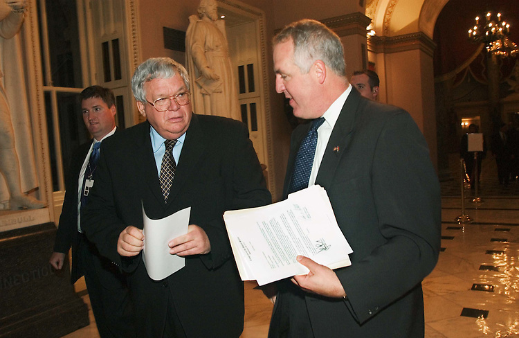 12/07/04.INTELLIGENCE REFORM CONFERENCE REPORT--House Speaker J. Dennis Hastert, R-Ill., and John Shadegg, R-Ariz., talk as they head to the floor for the vote on the intelligence reform bill in the House. Press secretary John Feehery is at left..CONGRESSIONAL QUARTERLY PHOTO BY SCOTT J. FERRELL