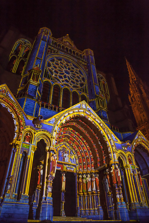 An ever changing light display on the exterior of Chartres Gothic Cathedral dazzles visitors.