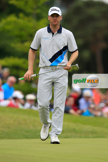 Michael Hoey (NIR) takes his putt on the 14th green during Sunday's Final Round of the 2014 Irish Open held at Fota Island Resort, Cork, Ireland. 22nd June 2014.<br /> Picture: Eoin Clarke www.golffile.ie