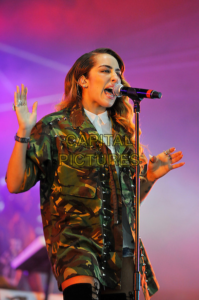 Delilah.performing at the Barclaycard Wireless Festival, Hyde Park, London, England. 7th July 2012..music live gig on stage show half length army camouflage jacket  microphone singing  white shirt otk thigh high socks black stockings lace-up hands.CAP/MAR.© Martin Harris/Capital Pictures.