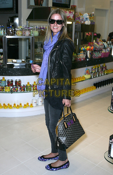 NICKY HILTON .Stops By Sugar Factory at the Miracle Mile Shops at Planet Hollywood Resort Hotel and Casino, Las Vegas, Nevada, USA, 19th March 2010.  .full length purple scarf sunglasses ballet pumps flats shoes black leather jacket bag print bows skinny jeans grey gray lolly pop lollypopRay Bans wayfarers side .CAP/ADM/MJT.© MJT/AdMedia/Capital Pictures.
