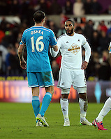 SWANSEA, WALES - FEBRUARY 07: L-R John O'Shea of Sunderland greets Ashley Williams of Swansea after the end of the Premier League match between Swansea City and Sunderland AFC at Liberty Stadium on February 7, 2015 in Swansea, Wales.