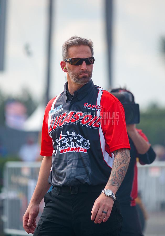 Mar 15, 2019; Gainesville, FL, USA; Aaron Brooks, crew chief for NHRA top fuel driver Dom Lagana during qualifying for the Gatornationals at Gainesville Raceway. Mandatory Credit: Mark J. Rebilas-USA TODAY Sports