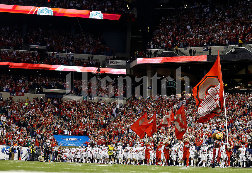 Ohio State Buckeyes take the field before the start of their game against Michigan State Spartans during the Big 10 Championship game at Lucas Oil Stadium in Indianapolis, Ind on December 7, 2013.  (Dispatch photo by Kyle Robertson)