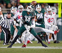 Ohio State Buckeyes cornerback Doran Grant (12) knocks the ball away from Michigan State Spartans wide receiver Tony Lippett (14) during the 2nd quarter at Spartan Stadium in East Lansing, Michigan on November 8, 2014.  (Dispatch photo by Kyle Robertson)
