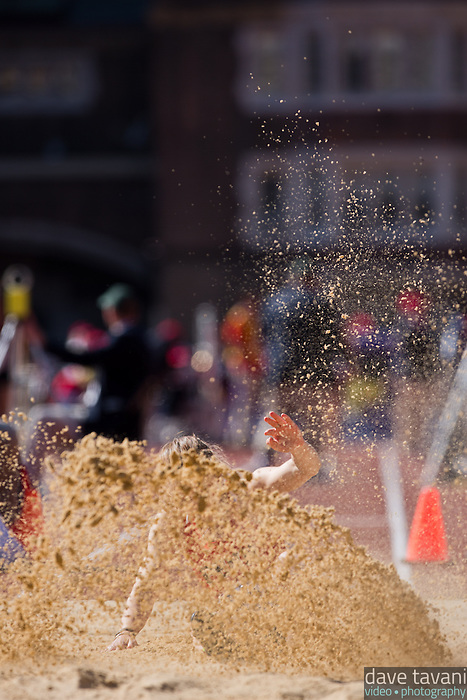 Gillian Berger, a long jumper for Penn makes a big splash in the sand during the College Womens Long Jump Easter on Thursday at the Penn Relays. Berger took 11th place with a jump of 5.49m.