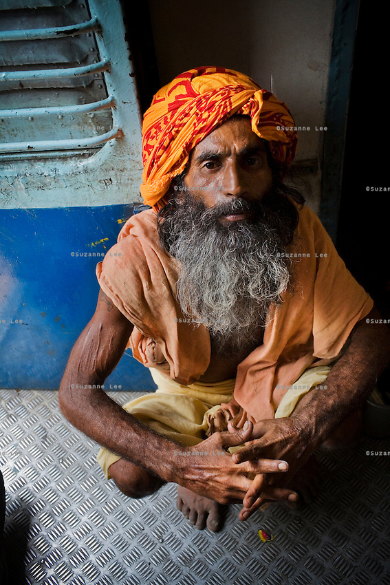 Sadhu on the Himsagar Express 6318 going from Jammu Tawi station to Kanyakumari on 7th July 2009.. .6318 / Himsagar Express, India's longest single train journey, spanning 3720 kms, going from the mountains (Hima) to the seas (Sagar), from Jammu and Kashmir state of the Indian Himalayas to Kanyakumari, which is the southern most tip of India...Photo by Suzanne Lee / for The National