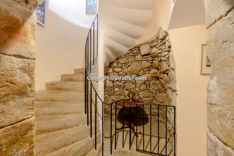 BNPS.co.uk (01202 558833)<br /> Pic: Strutt&Parker/BNPS<br /> <br /> A Spiral stone staircase<br /> <br /> A stunning castle that once belonged to. swashbuckling sailor who killed the real-life Jack Sparrow has gone on the market for offers over £1.9m.<br /> <br /> Coupland Castle in Northumberland is Grade I listed and is steeped in history dating back to the 12th century.<br /> <br /> It's Pele Tower was the last fortified building to be constructed in the Border area and before that the land on which it was built belonged to Sir John de Coupland, who captured the Scottish King at the Battle of Neville's Cross in 1346.<br /> <br /> During the 18th century a separate farmhouse was added to the south-west of the now L-shaped tower and it was sold in 1713 to Sir Chaloner Ogle.
