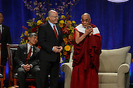 "May 7, 2013  (College Park, Maryland)  His Holiness the 14th Dalai Lama, Tenzin Gyatso, receives the Sadat Lecture commemorative artwork as a gift. The artwork, called ""Tangible,"" is designed by Mark Earnhart. The Dalai Lama was the guest speaker at the Anwar Sadat Lecture for Peace at the University of Maryland Comcast Center, May 7, 2013.  (Photo by Don Baxter/Media Images International)"