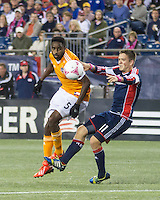 Houston Dynamo midfielder Warren Creavalle (5) and New England Revolution midfielder Kelyn Rowe (11) compete for a high ball.  The New England Revolution played to a 1-1 draw against the Houston Dynamo during a Major League Soccer (MLS) match at Gillette Stadium in Foxborough, MA on September 28, 2013.