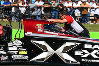 Sept. 22, 2013; Ennis, TX, USA: A crew member with NHRA top fuel dragster driver Spencer Massey during the Fall Nationals at the Texas Motorplex. Mandatory Credit: Mark J. Rebilas-