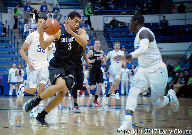 January 24, 2017:  San Diego State forward, Trey Kell #3, drives past Falcon guard, Trevor Lyons 320, during the NCAA basketball game between the San Diego State Aztecs and the Air Force Academy Falcons, Clune Arena, U.S. Air Force Academy, Colorado Springs, Colorado.  Air Force defeats San Diego State 60-57.
