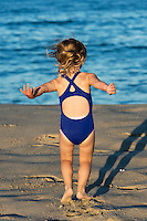 Girl play at the beach, Cape Cod, Massachusetts, USA