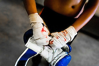 Geraldin Hamann's taped hands covered by blood are seen after a shadowboxing session in the boxing gym in Cali, Colombia, 26 June 2013. During the recent years, Kina Malpartida, a Peruvian female professional boxer, has won the World Championship title several times and so she has become a sporting idol and an inspiration for a generation of young girls throughout Latin America. Working out hard in poorly equipped gyms, they dream of becoming a boxing star. The Cauca Valley and the Caribbean coast are believed to be a home of the most talented female boxers in Colombia.