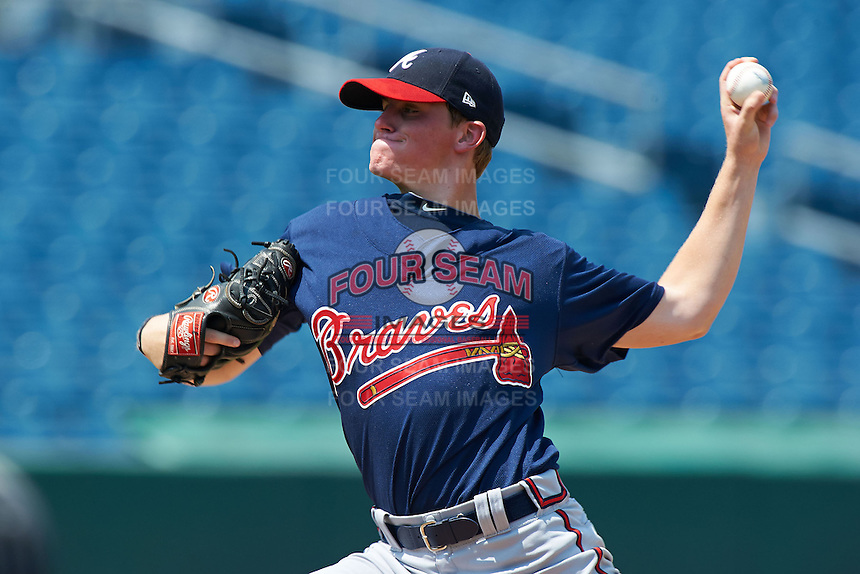 John Marshall #14 of Parkview High School in Lilburn, Georgia  playing for the Atlanta Braves scout team during the East Coast Pro Showcase at Alliance Bank Stadium on August 4, 2012 in Syracuse, New York.  (Mike Janes/Four Seam Images)