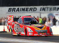Aug. 16, 2013; Brainerd, MN, USA: NHRA funny car driver Chad Head during qualifying for the Lucas Oil Nationals at Brainerd International Raceway. Mandatory Credit: Mark J. Rebilas-