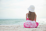 USA, Florida, St. Pete Beach, Rear view of girl (8-9) sitting on beach