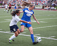 Sky Blue FC forward Monica Ocampo (8) attempts to tackle Boston Breakers defender Julie King (8) near the Breaker's goal.  In a National Women's Soccer League Elite (NWSL) match, Sky Blue FC defeated the Boston Breakers, 3-2, at Dilboy Stadium on June 16, 2013