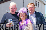 MARKING: Bill Cahill, Carmel and Eamon Fitzgerald (Abbeyfeale) marking their Race book at Listowel Races on Sunday..