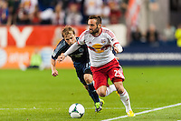 Brandon Barklage (25) of the New York Red Bulls is marked by Seth Sinovic (15) of Sporting Kansas City. Sporting Kansas City defeated the New York Red Bulls 1-0 during a Major League Soccer (MLS) match at Red Bull Arena in Harrison, NJ, on April 17, 2013.