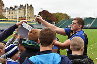 Stuart Hooper of Bath Rugby signs autographs at the end of the session. Bath Rugby Captain's Run on October 30, 2015 at the Recreation Ground in Bath, England. Photo by: Patrick Khachfe / Onside Images