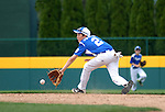 Little League baseball short stop trying to make the play.
