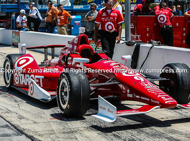 The Target Chip Ganassi Racing car in action during qualifying for the IZOD Indycar Firestone 550 race at Texas Motor Speedway in Fort Worth,Texas. IZOD Indycar driver Alex Tagliani (98) driver of the Team Barracuda-BHA car qualifies in the top spot during the Firestone 550 race..