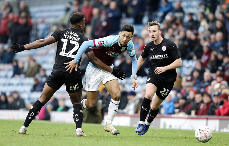 Burnley's Dwight McNeil looks to run past Dimitri Cavare<br /> <br /> Photographer Rich Linley/CameraSport<br /> <br /> Emirates FA Cup Third Round - Burnley v Barnsley - Saturday 5th January 2019 - Turf Moor - Burnley<br />  <br /> World Copyright © 2019 CameraSport. All rights reserved. 43 Linden Ave. Countesthorpe. Leicester. England. LE8 5PG - Tel: +44 (0) 116 277 4147 - admin@camerasport.com - www.camerasport.com