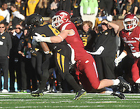 NWA Media/Michael Woods --11/28/2014-- w @NWAMICHAELW...University of Arkansas linebacker Brooks Ellis makes the tackle on Missouri running back Marcus Murphy in the 2nd quarter of Fridays game against Missouri at Faurot Field in Columbia Missouri.