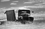 Old truck parked by the outhouse in Robsart, saskatchewan