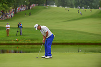 Hideki Matsuyama (JPN) sinks his birdie putt on 16 during Sunday's final round of the World Golf Championships - Bridgestone Invitational, at the Firestone Country Club, Akron, Ohio. 8/6/2017.<br /> Picture: Golffile | Ken Murray<br /> <br /> <br /> All photo usage must carry mandatory copyright credit (&copy; Golffile | Ken Murray)