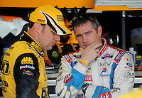 May 1, 2009; Richmond, VA, USA; NASCAR Sprint Cup Series driver Bobby Labonte (right) talks with Matt Kenseth during practice for the Russ Friedman 400 at the Richmond International Raceway. Mandatory Credit: Mark J. Rebilas-