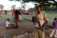 TANZANIA Mara, Tarime, village Masanga, region of the Kuria tribe who practise FGM Female Genital Mutilation, temporary rescue camp of the Diocese Musoma for girls which escaped from their villages to prevent FGM, , armed policeman secures the camp / TANSANIA Mara, Tarime, Dorf Masanga, in der Region lebt der Kuria Tribe, der FGM weibliche Genitalbeschneidung praktiziert, temporaerer Zufluchtsort fuer Maedchen, denen in ihrem Dorf Genitalverstuemmelung droht, in einer Schule der Dioezese Musoma, bewaffnete Polizisten schuetzen das Camp