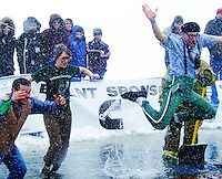Ben Ruyle (right) jumps into frozen Lake Monona, followed by Nate Ruyle and Kelly Hofer at the Polar Plunge at Olin Park on Saturday morning, 2/21/09