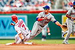 1 August 2018: Washington Nationals shortstop Trea Turner slides safely into second as he steals his 27th base of the season with New York Mets shortstop Phillip Evans unable to get the throw in the first inning at Nationals Park in Washington, DC. The Nationals defeated the Mets 5-3 to sweep the 2-game weekday series. Mandatory Credit: Ed Wolfstein Photo *** RAW (NEF) Image File Available ***