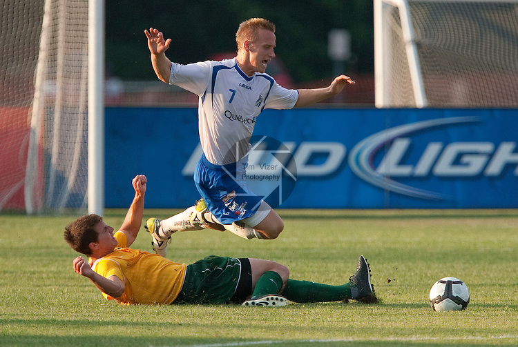 SPO-Montreal Impact vs AC St. Louis.10 July 2010 - .ST. LOUIS -                           Montreal Impact Midfielder David Testo (7, top) begins to fall after he was slide-tackled from behind by AC St. Louis Midfielder Troy Cole (3) in the first half.  The Montreal Impact played the AC St. Louis at the Anheuser-Busch Soccer Park in St. Louis, MO, on Saturday July 10, 2010.