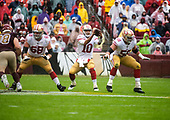 San Francisco 49ers quarterback Jimmy Garoppolo (10) takes the snap from San Francisco 49ers center Weston Richburg (58) in first quarter action against the Washington Redskins at FedEx Field in Landover, Maryland on Sunday, October 20, 2018.  Also pictured is San Francisco 49ers offensive guard Mike Person (68).  The 49ers won the game 9 - 0.<br /> Credit: Ron Sachs / CNP