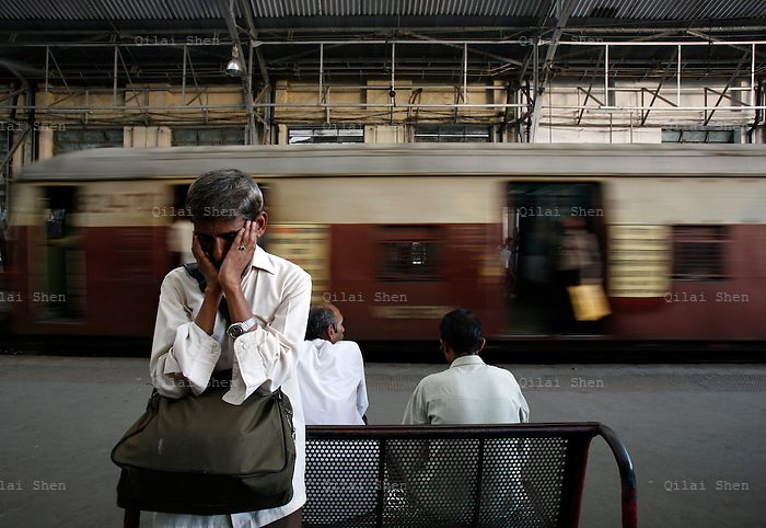 A man says a prayer at the Churchgate Station in Mumbai, India on Friday, 29 December 2006.